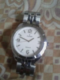 round silver analog watch with silver chain Howrah, 711101