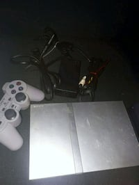 PS2 Slim Silver w/ 20 games
