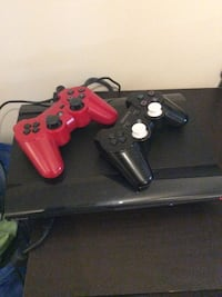 black Sony PS3 slim console with two controllers Mont-Royal, H3P