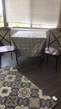 Dining table, wood chairs, floral table cloth Alexandria, 22302