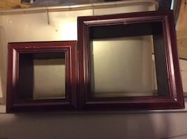 two square brown wood frames