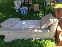 Beige and red chaise lounge