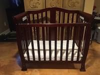 Baby crib has three levels this pic is the lowest level comes with mattress and a removable mattress pad that is water resistant fitted sheet and bumper pads Plymouth