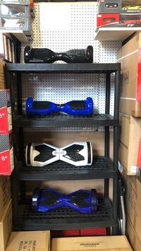 four blue, white, and black self-balancing boards and gray plastic 4-layer rack Pickering, L1W 4B9