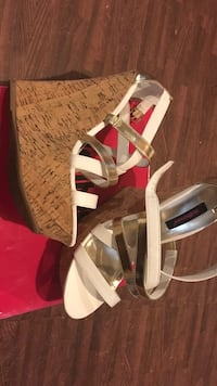 pair of white leather open toe ankle strap heels Edmonton, T6W 1Y9