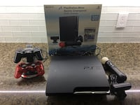 Sony ps3 with 2 extra controllers and games Toronto, M9M 2J9
