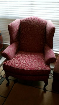 red and brown floral sofa chair