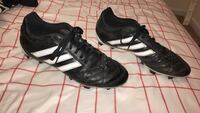 Pair of black-and-white Adidas soccer cleats Cumming, 30040