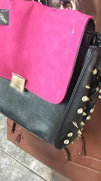 studded black and pink leather bag