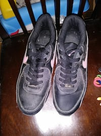 pair of black-and-pink Nike running shoes Barstow, 92311