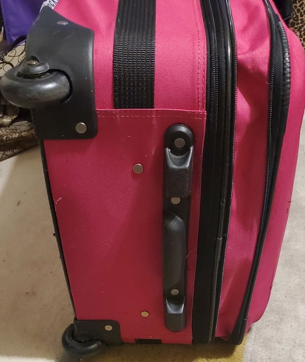 Pink Rolling Suitcase Luggage  f83cac08-4b01-4a37-b113-76581d56034d
