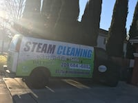 white, black, and blue Steam Cleaning panel van