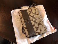 brown and white Coach monogram leather wristlet Elk Grove, 95624