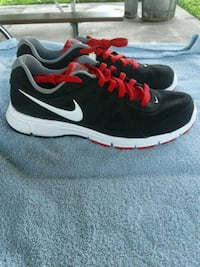 black-and-white Nike running shoes Clearwater, 33755