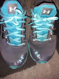 pair of black-and-blue Nike running shoes Moncton, E1C 6N5