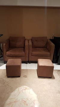 Pair of microfiber bucket chairs and foot stools