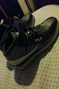 pair of black-and-gray Nike running shoes 415 mi