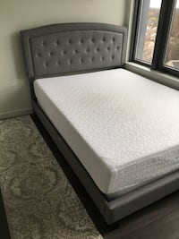 Upholstered Queen Bed frame only . Extra for mattress and box- Barley used Arlington, 22201