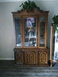 brown wooden framed glass display cabinet Baton Rouge, 70820