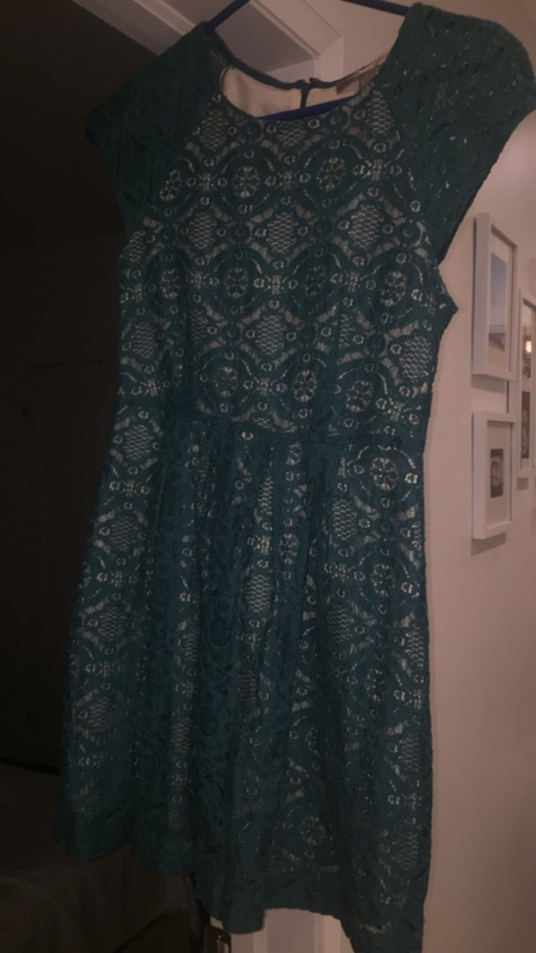 Lace dress with nude underlay .