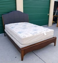 brown wooden bed frame with white mattress Frisco, 75034