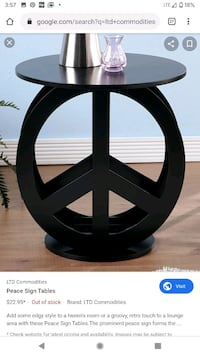 Black peace sign wooden table