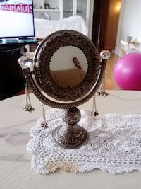 Danish design mirror with cute cuts and details.
