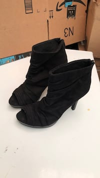 Pair of black  heeled boots