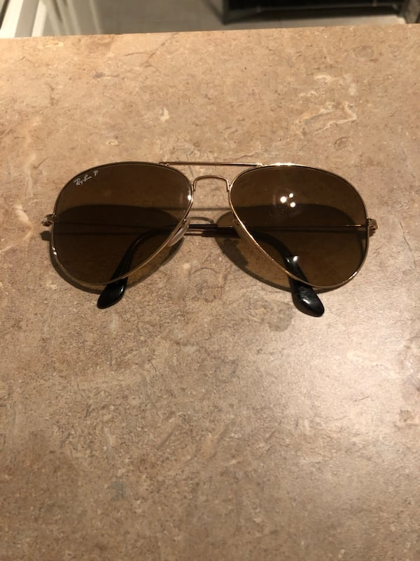 Polarized light brown/gold trim sunglasses- gently used 66364f87-dd89-4078-b917-3032741b3560