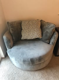 gray suede sofa chair with throw pillow 1996 mi