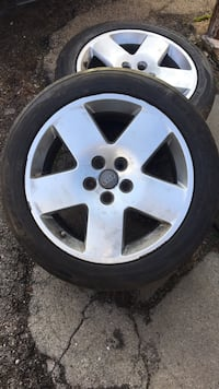 Gray 5-spoke vehicle wheel and tire Youngstown, 44512
