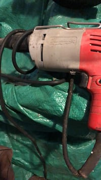 Red and black corded power tool