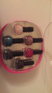 several assorted color nail polish bottles and nail dryer  Winnipeg, R2J 3Z6