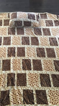 brown and black bedspread