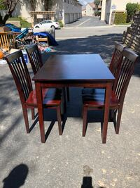 rectangular brown wooden table with four chairs dining set Thousand Oaks, 91320