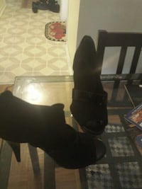 pair of black leather boots Toronto, M3N