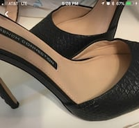 Black leather platform pumps nearly new Boca Raton, 33431