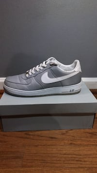 A pair of gray and white nike air force 1 low Hoover, 35226