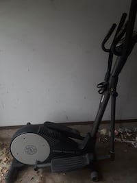 black and gray Strided Trainer elliptical trainer