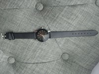 round silver-colored analog watch with black leather strap Montréal, H8S 3L5