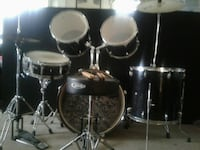 Acoustic drum set. 2 sets of drumsticks included Howell, 07731