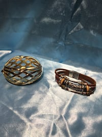 Gold coloured bangle and leather braided bracelet  Kelowna, V1W