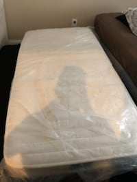 Like new white and black bed mattress and frame