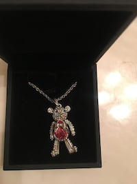 "Multi colored Swarovski Crystal teddy bear necklace with movable head, arms and legs. New with box. Never worn. 20"" adjustable chain. Stainless steel   Chattanooga, 37421"