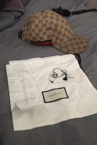 Authentic Gucci hat comes with holt renfrew receipts,tags and dust bag Surrey, V3W 7T9