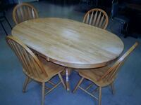 Oval brown wooden table with four chairs dining s Brampton, L7A 1R9