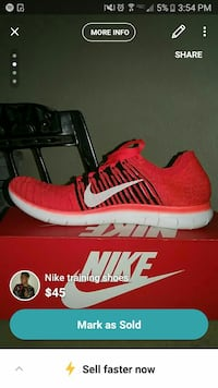 unpaired red Nike Training shoe with box
