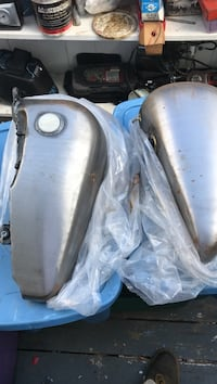 two gray motorcycle gas tanks