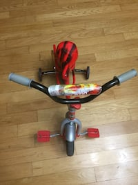 red and gray bike with training wheels