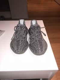 pair of black Adidas Yeezy Boost 350